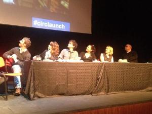 An author panel sit stunned as their writing story gets projected above their heads....